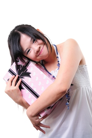 girl smiles and holding a gift in packing Stock Photo - 13653837