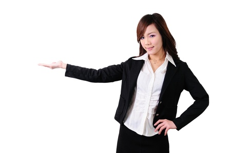 businesswoman in suit outstraching her hand for presenting something