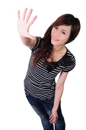 白い背景で隔離された高いポイントに伸ばし、手のひらで美しい女性 写真素材