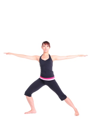 Young healthy woman standing a yogatic stance