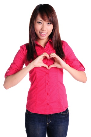 form of heart shaped by the hands of a beautiful young women  photo