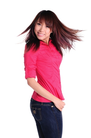 Young pretty smiling girl with long hair   Shot in studio over white  Stock Photo