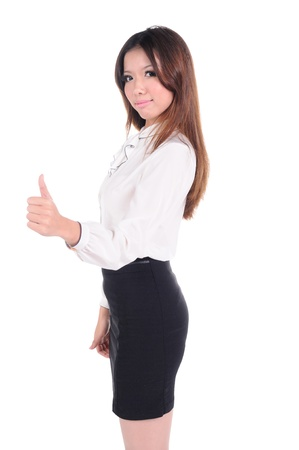 young female shows thumb up gesture, isolated on white