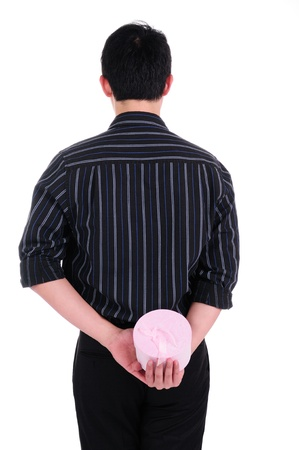 a businessman with gift behind his back