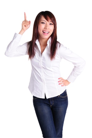 Portrait of attractive businesswoman pointing her finger and smiling, over white background