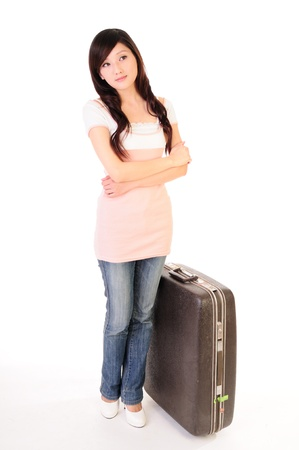 Woman with luggage waiting and looking up away somewhere isolated on white background