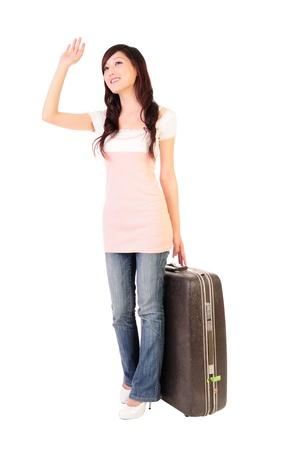 smiling woman wave goodbye   Isolated over white background  photo