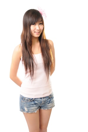 Beautiful casual young woman standing isolated against white background  Stock Photo