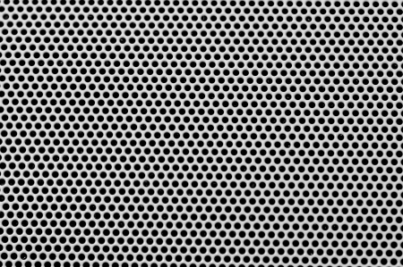 metal grid: Background sheet of metal covered with lines of circular holes
