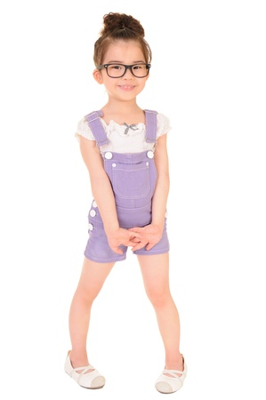 women children: Beautiful girl wearing glasses isolated on white  Stock Photo