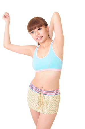 A young woman doing some exercises over white background
