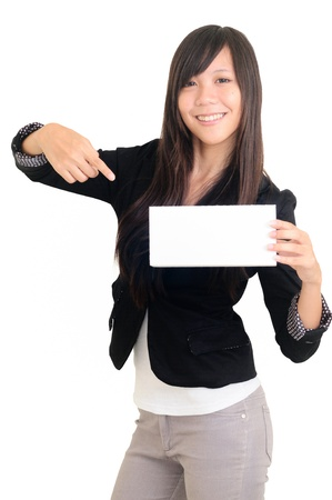 Portrait of a happy young woman with bussiness card against white background  Stock Photo - 13821384