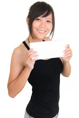 Portrait of a happy young woman with bussiness card against white background