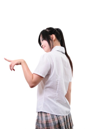Japanese student pointing a finger at the left, isolated on white background  Stock Photo
