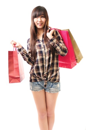 Shorts with a shopping bag of beautiful young girls in white background full length Asian Caucasian ethnicity