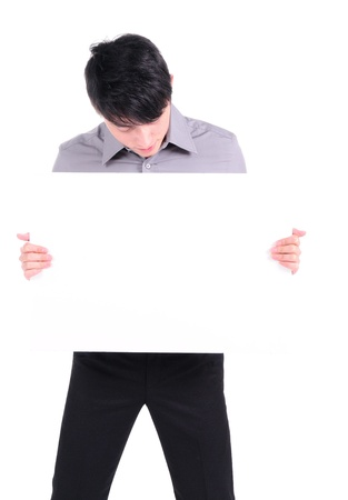 A business man holding an empty sign  Stock Photo