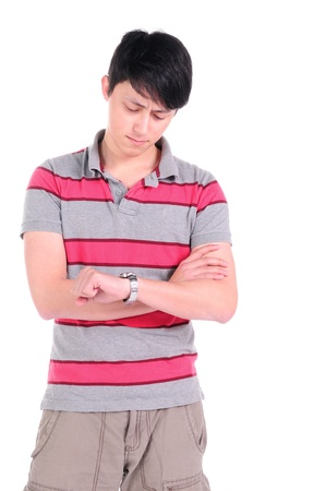 Young man looking at his watch over white background  Stock Photo