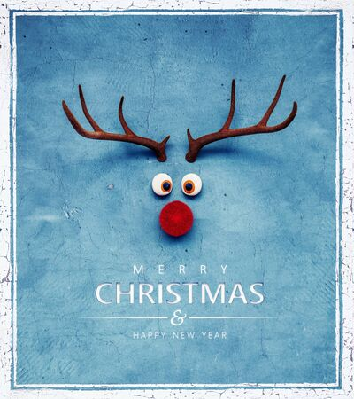 Christmas Reindeer with red cold nose on blue background 3D Rendering Banco de Imagens