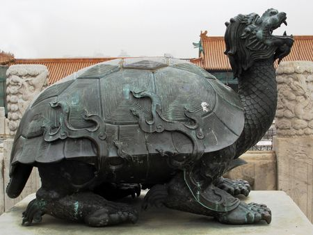 bejing: The dragon-headed turtle is a Chinese symbol of wealth, health, prosperity and long life.  This large statue is located in the Forbidden City, Bejing, China. Stock Photo