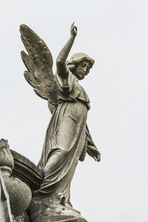 angel cemetery: angel statue in the cemetery guarding the graves of the dead.