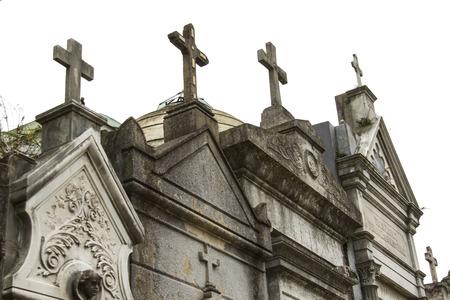 the sacrament: Diferent crosses ont top of building