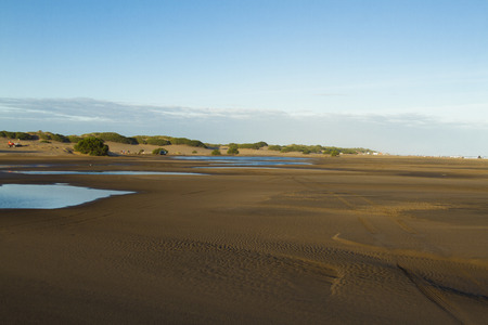 brackish water: Deserted beach on the coast of Argentina with remnants of the tide pools of brackish water