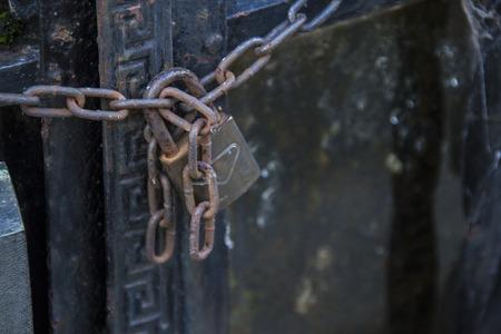 keep gate closed: chain with padlock closing doors