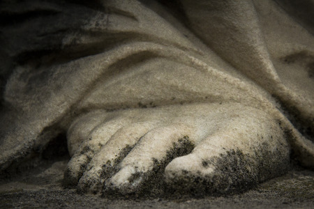 devout: foot sculpture of a devout woman Stock Photo