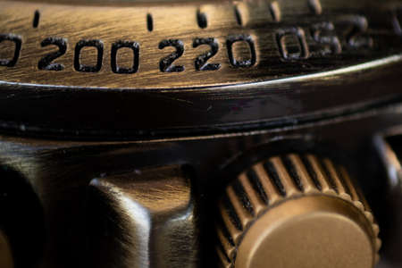 Close-up of the numbers on the outer ring of a watch. Selective focus, shallow depth of field.