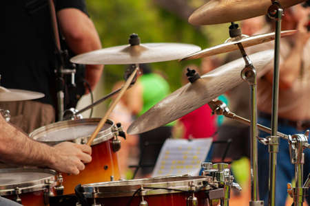 Close Up Of Drummer Playing Snare Drum On Kit In square during musical performace. Stockfoto