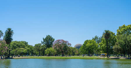 Artificial lagoon that limits one of the parks in the forests of Palermo, Buenos Aires. in the background you can see the planetarium. Panorama.