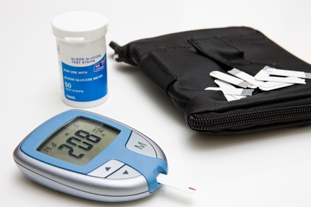 glucose: Glucometer, Test Strips and Case Stock Photo