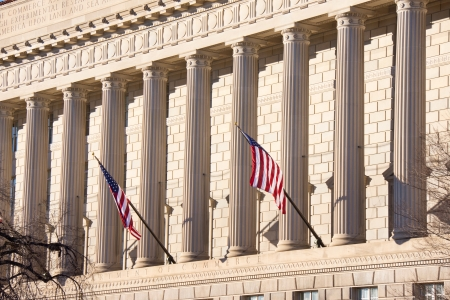 Flags Fly in Front of Government Building