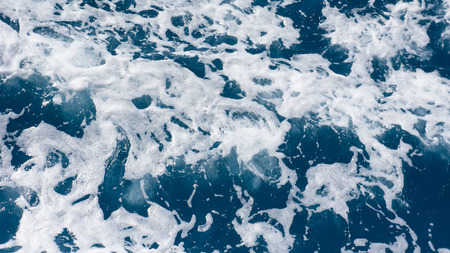 foamy: Restless foamy blue sea water from above Stock Photo