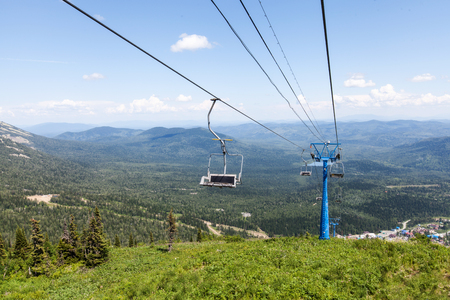 climbing cable: Chairlift, scenic view from high mountain, summer landscape Stock Photo