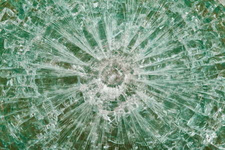 bulletproof: Bulletproof glass after the shooting with traces of bullets, test, close-up