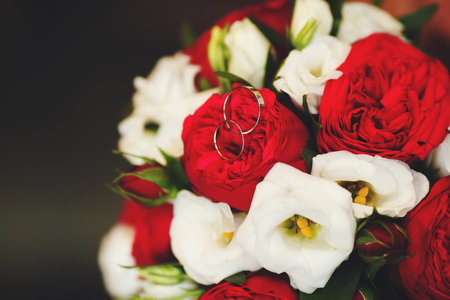 Beautiful wedding bouquet of red and white roses, selective focus, close-up