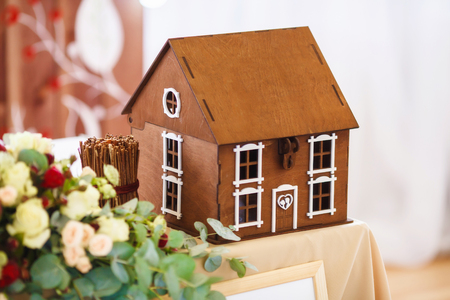 Small model of house, wedding table decoration, closeup