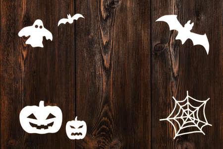 haloween: Paper haloween figures on wooden background with copy space. Abstract conceptual image