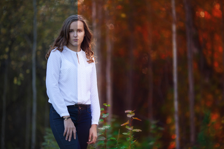 Photo before and after the image editing process. Young beautiful woman in the autumn forest Stock Photo