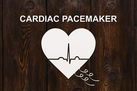 electrocardiograph: Heart shape with echocardiogram and CARDIAC PACEMAKER text. Medical cardiology concept