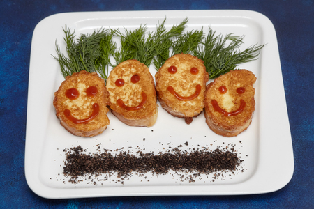Meat cutlets in smile shape on plate. Creative kids menu