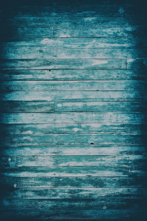 Old blue toned shabby wooden planks with cracked color paint, vertical background