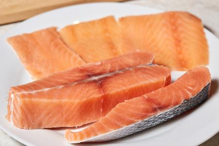 Salmon raw fish fillet on plate, closeup