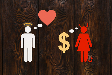 Paper couple, love vs money concept. Angel man and devil woman. Abstract conceptual image