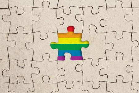 Missing jigsaw puzzle piece and rainbow flag. Lgbt pride concept Standard-Bild - 115768385