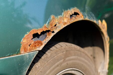 Rusty right wing of car with corrosive defect. Corrosion and rust Stockfoto
