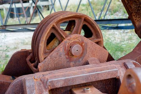 Old rusty gears or mechanical parts, crane mechanism closeup