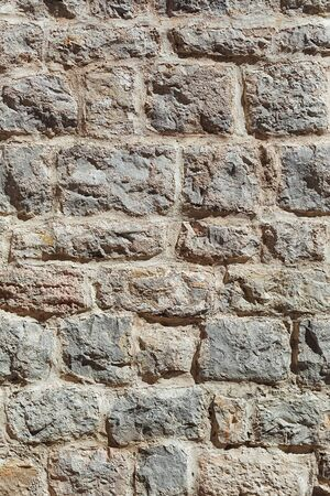 Part of a big stone wall for background or texture, closeup