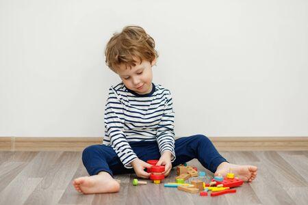 Child boy sitting and playing. Stay home concept, Coronavirus Covid-19 quarantine